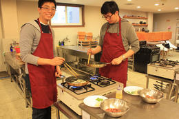 Two of my classmates make cooking bulgogi look easy. - January 2013