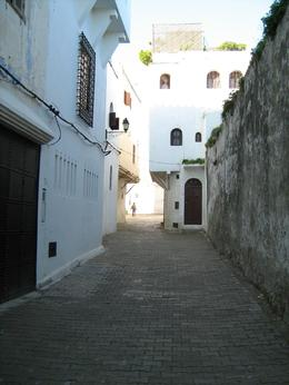 An unusually serene view of one of the side streets. Normally they are packed with people from the tour and the locals. I couldn't get over how narrow the Casbah was until I realized it was made ... , James A - February 2008