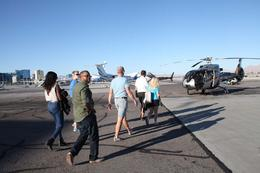 Our pilot leads the group to the helicopter for the sunset tour , Scott M - November 2016