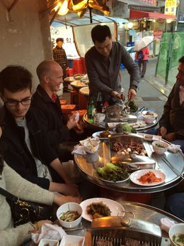 Joon, our tour guide, showing us how to prepare Korean style bbq. Lots of accompaniments to the meat and mushrooms - had no idea you ate this inside a lettuce or mint leaf. , Jan - April 2015
