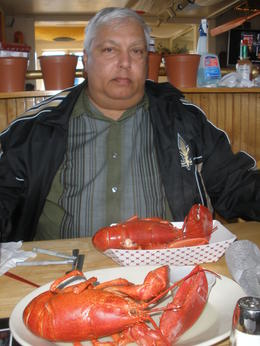 My husband enjoying some lobster in Kennebunkport , MinnieMouse - November 2013