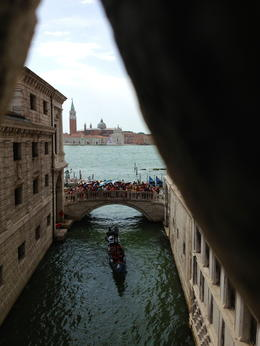 Walking from the Doges Palace to the new prisons, passing across the Bridge of Sighs as the prisoners would have done years ago. , linda - August 2013