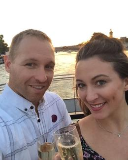 Having a glass of champagne while watching the sunset on the river cruise and viewing the sites , Molly R - September 2016