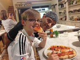 Mackenzie eating his home made Pizza at the Cookery class in Florence , Sharon F - November 2015