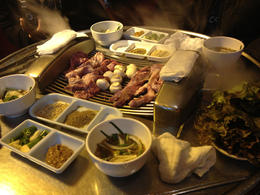Steam escapes from the sides of the tabletop grill as we wait for our pork and mushrooms to cook. - May 2013