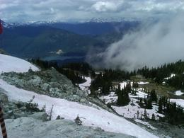 Looking down at Whistler Village from the top after getting off gondola ride up the mountain. Slopes had closed only two weeks earlier (mid-July). it was the first time I have ever walked in snow..., Mabelle B P - August 2011