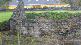 House in back built by descendants of those who once lived in the ruins. , Roger G - October 2017