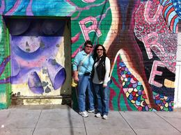 Standing in front of the AIDS memorial wall in the Castro , Jeanelle C - March 2011