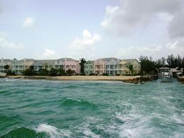 Taking off on our boat from the harbor. Colorful Bahamas buildings on the beach. , Leah - July 2011
