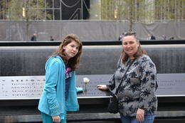 This is my Wife LeAnn and our Daughter Marlee in front of the 9/11 Memorial. , Brian H - May 2014