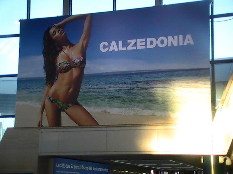 bill board at iberlia airlines check in counter r ome italy 6/24/12 - Rome