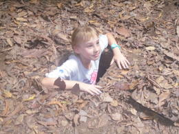 My granddaughter coming out of one of the Cu Chi Tunnels , vickindicky - August 2017