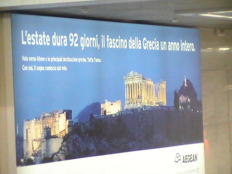 bill board a t check in counter iberia airlines rome italy 6/24/12 - Rome