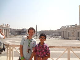 My son with our tour guide,behind is St.Peter's Square , Amor A - August 2013