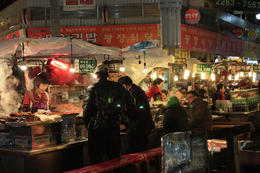 The alleys of Gwangjang Market are filled with stalls selling bindaetteok, seafood and street food. - May 2013