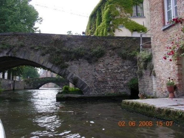 Streaming river under a little bridge - Brussels
