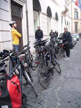 Our guide Bruno watching our bikes while we stopped to take a picture at the Trevi Fountain. , Eileen T - March 2014