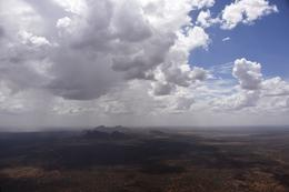Approaching Kata Tjuta by helicopter as storm hovers over it. , Fred J - February 2018