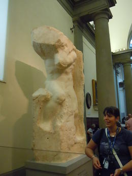 Guide Fredrika describing Michaelanglo's unfinished sculptures in the Accademia gallery. , J B - August 2014