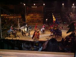 Here is a picture with all the Knights in the arena, they were showing off their costumes to their respective crowd (section of the audience ) and we would cheer for HIM. The horses are magnificent... - September 2008