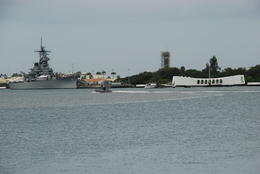 Beginning and end of World War 2 for the USA. Arizona Bridge Memorial on right and USS Missouri on left at Pearl Harbour , Margaret - May 2011