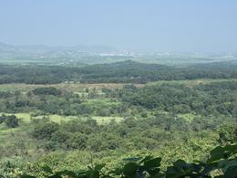 This is the view of North Korea from the Dora Observatory. In the distance you can see the North Korean city of Kaesong. , William B - August 2016