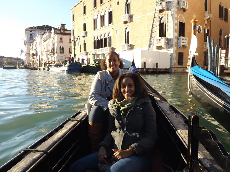 Sisters enjoying a gondola ride in Venice, Italy - Venice