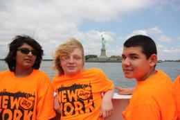 Erik, Michael and Mathieu pose for a minute whille on the cruise. This was a trip with our Arts Academy to NYC! , MADALYN W - June 2012