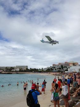 Maho beach was very crowded until after the KLM flight came in (this is not that flight). The beach bar thinned out after that and the drinks are very reasonably priced. , Jean Marie K - February 2014