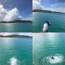 The boy jumping off the boat at Flamenco Beach , Karen C - November 2016