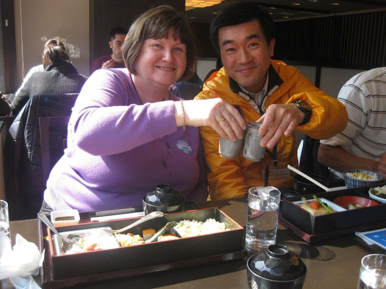 Our guide and me sampling lunch - Tokyo