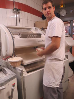 Watching the local baker produce some of the 800 baguettes a day he makes. , Lyn - October 2013