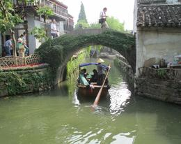Group of tourists riding in one of the many gondolas on a canal in Suzhou , Marion S - June 2013