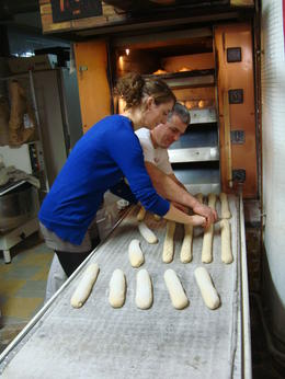 Helping out with the baguette making, Emily - October 2012