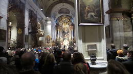 This is in Krems and is a distinctly different architecture to other churches we visited. The inside of the church has extraordinary artwork, This picture was taken during the childrens' service on ... , Donal C M - January 2015