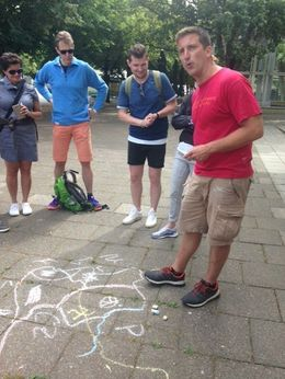 Andrew gives us a sidewalk history lesson on Germany during a bike tour in Berlin. , Heidi F - July 2016