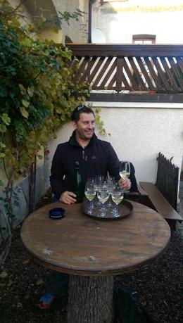 Adam, our awesome guide, brings out the wine for tasting at one of the wineries. , Hanna G - December 2014