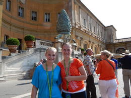 Our daughters standing in the Pine Cone Garden, early during our tour of the Vatican Museum. , Andrew G - July 2013