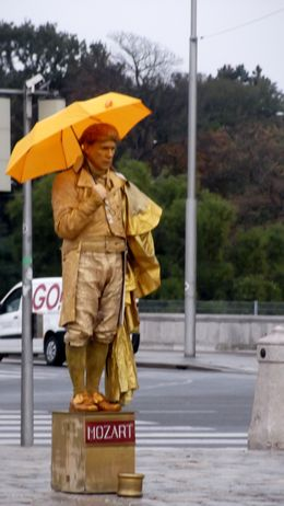 The golden mime of Mozart holds his umbrella to protect himself from the rain , Ed D - October 2015