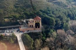 This is a view from cable car looking down below as the car lifts up to get to Montserrat., Elizabeth D - February 2009