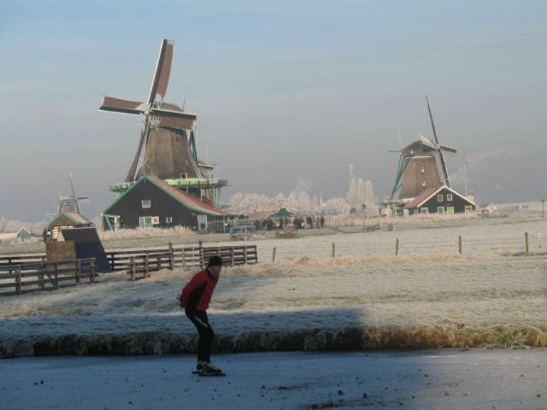 Skaters at Zaanse Schans Windmill - Amsterdam