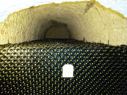 Stacks of champagne bottles in Taittinger cellar. , girltracey - June 2015