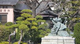 This statue is to honor a Noh Actor. It is placed next to the main Temple in Asakusa., Martha W - March 2010