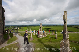 A tourist encounters a celtic cross on a gravestone at The Rock of Cashel. , Christopher W H - August 2016
