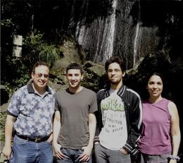 Here are the four of us in front of a waterfall in El Yunque; photo taken by our guide., Richard S - September 2008