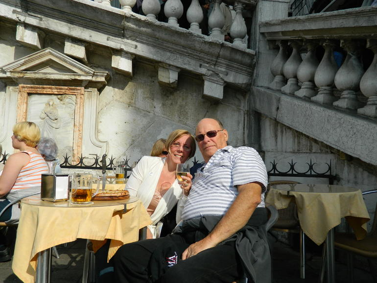 Having an adult beverage at the base of the Rialto Bridge - Venice