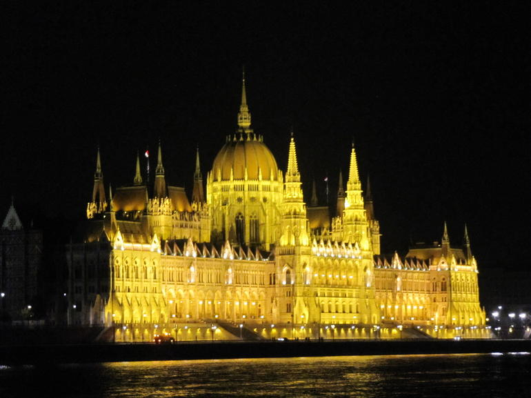 Parliament Building at night from Danube Cruise - Budapest