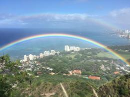 Rare west side rainbow seen from the lookout on top of Diamond Head. Never sen a rainbow from above. We could clearly see both ends. I glimpsed a pot of gold but it was gone before I plucked up the ... , Michael G - September 2016