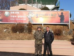This photo was taken with a Lieutenant at a strategic overlook just outside the DMZ in the and quot;Civilian Control Zone and quot; on the way to the North Korea Spy Commando Invasion route. I was ... , Alan - March 2015