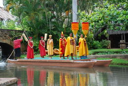 Parade of differnet cultures on canoes. Gold clothing represents Royality and red representing servants. , Margaret - May 2011